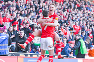 Cauley Woodrow of Barnsley (9) scores a goal and celebrates with Ryan Hedges of Barnsley (7) to make the score 2-1 during the EFL Sky Bet League 1 match between Barnsley and Coventry City at Oakwell, Barnsley, England on 30 March 2019.