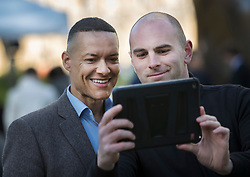 © Licensed to London News Pictures.18/04/2017.London, UK. Labour MP Clive Lewis (L) stops for a selfie near Parliament. British Prime Minister Theresa May has called a surprise general election for June 8 th. Photo credit: Peter Macdiarmid/LNP