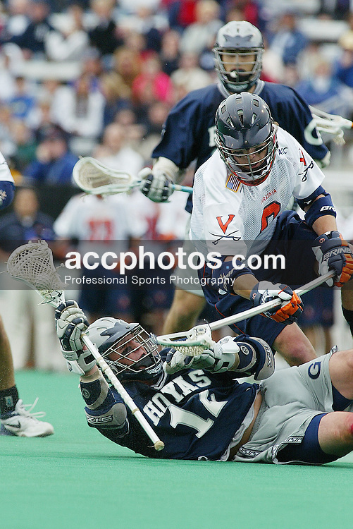 5/18/03  3:24:07 PM..Georgetown Hoya Mike Hammer (12) is taken out..Georgetown Men's Lacrosse v. University of Virginia at Charlottesville..NCAA Round 2 - Quarterfinals.@ Townson University..DIGITAL IMAGE - EOS 1D