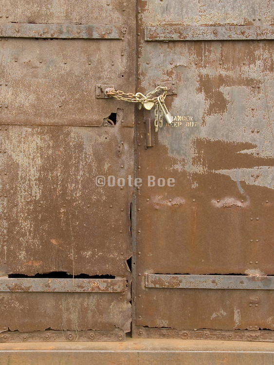 old metal door locked with a padlock and chain