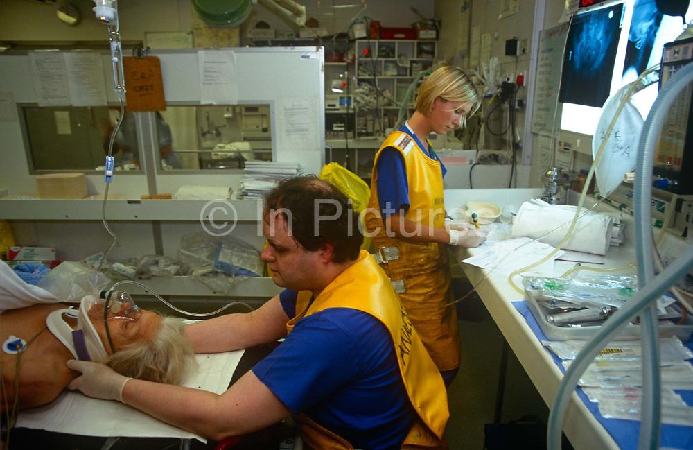 An A&E nurse supports the head of an emergency patient wearing a head brace in the London Hospital, Whitechapel, on 23rd June 1993, in London, England.