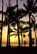 Sunset with couple, Waikiki, Oahu, Hawaii<br />