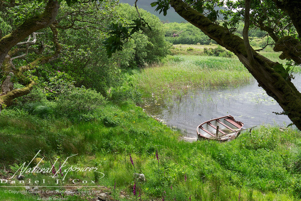 An old boat on the lake near Kylemore Abbey, Ireland.