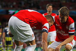 27.08.2013, Emirates Stadion, London, ENG, UEFA CL Qualifikation, FC Arsenal vs Fenerbahce Istanbul, Rueckspiel, im Bild Arsenal's Lukas Podolski clutches his hamstring during the UEFA Champions League Qualifier second leg match between FC Arsenal and Fenerbahce Istanbul at the Emirates Stadium, United Kingdom on 2013/08/27. EXPA Pictures © 2013, PhotoCredit: EXPA/ Mitchell Gunn<br /> <br /> ***** ATTENTION - OUT OF GBR *****
