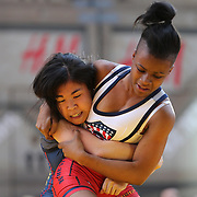 Girl wrestlers Amy Farusho, New Jersey, in action against  Ronnie Green, (right), New York City, during the 'Beat The Streets' USA Vs The World, International Exhibition Wrestling in Times Square. New York, USA. 7th May 2014. Photo Tim Clayton