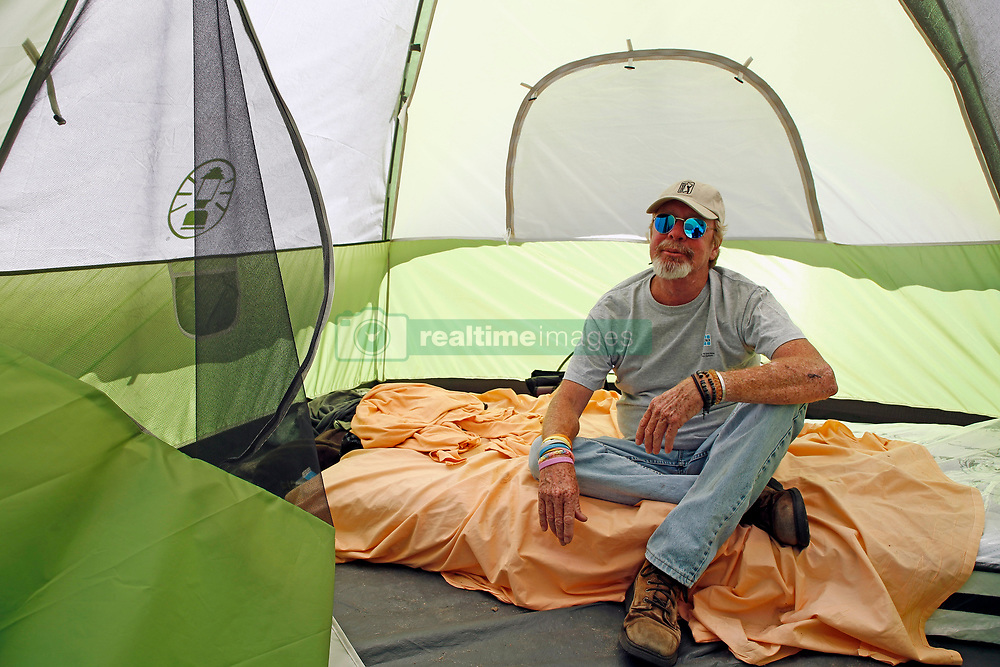 April 2, 2020, Tampa, Florida, USA: TIM GAINER, 55 poses inside of his new temporary home, tent #45. After two days the emergency homeless shelter setup by Catholic Charities of the Diocese of St. Petersburg and the City of Tampa was completely filled. (Credit Image: © Luis Santana       Times/Tampa Bay Times via ZUMA Wire)