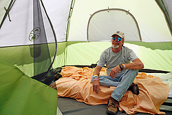 April 2, 2020, Tampa, Florida, USA: TIM GAINER, 55 poses inside of his new temporary home, tent #45. After two days the emergency homeless shelter setup by Catholic Charities of the Diocese of St. Petersburg and the City of Tampa was completely filled. (Credit Image: © Luis Santana   |   Times/Tampa Bay Times via ZUMA Wire)