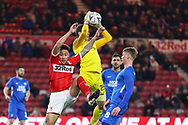 Peterborough United goalkeeper Conor O'Malley (25) claims the ball ahead of Middlesbrough midfielder Marcus Tavernier (28) during The FA Cup 3rd round match between Middlesbrough and Peterborough United at the Riverside Stadium, Middlesbrough, England on 5 January 2019.