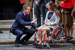 © Licensed to London News Pictures. 22/10/2015. London, UK. Prime Minister David Cameron meets Emma Pack before buying a Royal British Legion poppy in Downing Street, London on Thursday, 22 October 2015. Photo credit: Tolga Akmen/LNP