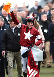 Jockey Keith Donoghue celebrates winning the Glenfarclas Chase on Tiger Roll during Ladies Day of the 2018 Cheltenham Festival at Cheltenham Racecourse.