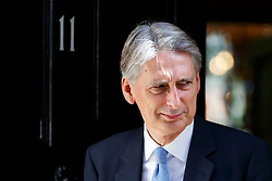 © Licensed to London News Pictures. 18/07/2016. London, UK. Chancellor of Exchequer PHILIP HAMMOND leaving No 11, Downing Street on Monday, 18 July 2016. Photo credit: Tolga Akmen/LNP