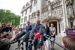 © Licensed to London News Pictures. 07/06/2018. London, UK. Northern Ireland Human Rights Commission's (NIHRC) Chief Commissioner Les Allamby (C) speaks to media outside the Supreme Court after the court said it could not rule on an appeal against Northern Ireland's strict abortion laws, but that it would have declared them incompatible with human rights laws otherwise. Photo credit: Rob Pinney/LNP