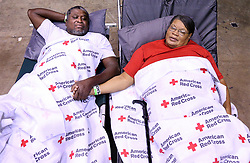 "Clarence and Virginia Robinson move into the Red Cross shelter at the Albany Civic Center to ride out Hurricane Irma on Sunday, September 10, 2017, in Albany, Ga. The couple survived Tropical Storm Alberto in 1994, a storm that killed five people in Dougherty County, and more recently two tornado strikes in January of this year that killed four. Virginia Robinson said, ""I feel more safe here and our street is already flooding."" Photo by Curtis Compton/Atlanta Journal-Constitution/TNS/ABACAPRESS.COM"