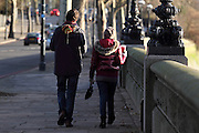 People walking along the Chelsea Embankment on a Sunday morning in winter