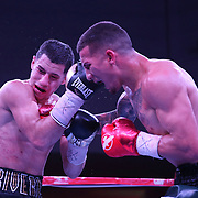 Jason Sanchez punches Jean Carlos Rivera during their championship boxing match for the WBO Junior World Title at the Hotel El Panama Convention Center on Wednesday, October 31, 2018 in Panama City, Panama. (Alex Menendez via AP)