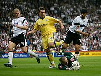 Photo: Steve Bond.<br />Derby County v Southampton. Coca Cola Championship. Play Off Semi Final, 2nd Leg. 15/05/2007. Stephen Bywater saves at the feet of Marek Saganowski (C).  Dean Leacock (R) & Jay McEveley (L) attaend