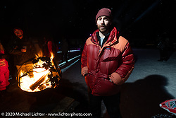 Sean Lichter on Lake Baikal at the wrap party (in 6 degree F/ -14.5 C weather) after the close of the Baikal Mile Ice Speed Festival. Maksimiha, Siberia, Russia. Saturday, February 29, 2020. Photography ©2020 Michael Lichter.