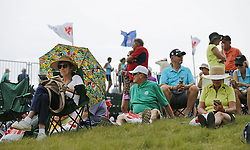 August 3, 2018 - Blaine, MN, USA - Fans wait for a light rain shower to pass at the 1st tee during the opening round of the Champions Tour's 3M Championship at the TPC in Blaine, Minn., on Friday, Aug. 3, 2018. (Credit Image: © Shari L. Gross/TNS via ZUMA Wire)