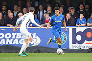AFC Wimbledon striker Lyle Taylor (33) dribbling and taking on Northampton Town defender Zander Diamond (5) during the EFL Sky Bet League 1 match between AFC Wimbledon and Northampton Town at the Cherry Red Records Stadium, Kingston, England on 11 March 2017. Photo by Matthew Redman.