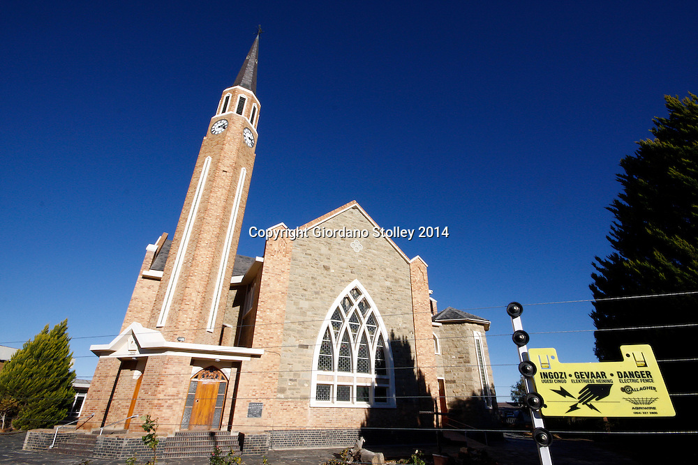 CARNARVON - 10 July 2014 - Even churches in South Africa are not safe from criminals, with the Dutch Reformed Church in South Africa's Northern Cape province being protected by electric fencing. This building, erected in 1954, replaced the original church that stood on the same site from 1883 to 1952. Picture: Allied Picture Press/APP