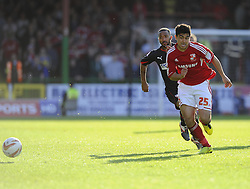 Swindon Town's Massimo Luongo chases the loose ball - Photo mandatory by-line: Joe Meredith/JMP - Tel: Mobile: 07966 386802 04/05/2013 - SPORT - FOOTBALL - County Ground - Swindon - Swindon Town v Brentford - Npower League one Play Off