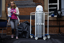 © Licensed to London News Pictures. 08/04/2020. Manchester, UK. A Thor UV-C Robot that uses ultra violet light to destroy the DNA of any virus , bacteria or spore. When all costs are accounted for , the £40,000 device will sterilise the interior of an ambulance in 2 minutes at a cost of 50 pence . It will be used to clean patient bays , ambulances used to transport patients and other facilities . The National Health Service is building a 648 bed field hospital for the treatment of Covid-19 patients , at the historical railway station terminus which now forms the main hall of the Manchester Central Convention Centre . The facility is due to open on Easter Monday , 13th April 2020 , and will treat patients from across the North West of England , providing them with general medical care and oxygen therapy after discharge from Intensive Care Units . Photo credit: Joel Goodman/LNP