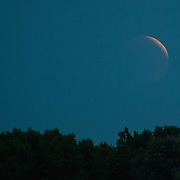 VENICE, ITALY - JUNE 15:  Partial eclipse of the moon is seen on June 15, 2011 in Venice, Italy. The longest lunar eclipse for a decade took place tonight, a lunar eclipse comes when the sun, Earth and moon line up and Earth's shadow falls on the moon