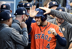 November 1, 2017 - Los Angeles, California, U.S. - Houston Astros' GEORGE SPRINGER (4) is congratulated by teammates after scoring in the 1st inning of game seven of a World Series baseball game at Dodger Stadium on Wednesday. (Credit Image: © Keith Birmingham/Los Angeles Daily News via ZUMA Wire)