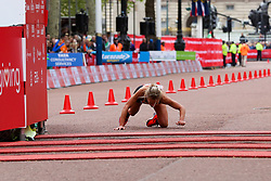 © Licensed to London News Pictures. 28/04/2019. London, UK. A women runner falls down just before the finish line at the London Marathon 2019. Photo credit: Dinendra Haria/LNP
