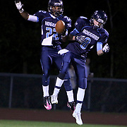 Hoggard's Harrison Smith, left and Eric Leifheit celebrate a touchdown against West Brunswick Monday night at Hoggard High School. (Jason A. Frizzelle)