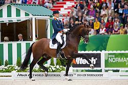Hans Peter Minderhoud, (NED), Glock's Johnson N.O.P. - Grand Prix Special Dressage - Alltech FEI World Equestrian Games™ 2014 - Normandy, France.<br /> © Hippo Foto Team - Leanjo de Koster<br /> 25/06/14