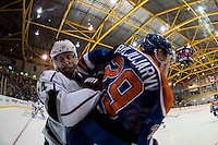KELOWNA, CANADA - OCTOBER 2: Tom Gilbert #14 of the LA Kings checks Jesse Puljujarvi #39 of the Edmonton Oilers into the boards on October 2, 2016 at Kal Tire Place in Vernon, British Columbia, Canada.  (Photo by Marissa Baecker/Shoot the Breeze)  *** Local Caption *** Tom Gilbert; Jesse Puljujarvi;