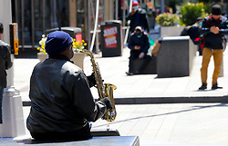Man is playing saxophone in Times Square during the Covid-19 pandemic in New York City, NY, USA on April 22, 2020. The Big Apple neared a painful milestone Wednesday as the death toll from the coronavirus outbreak that has ravaged the five boroughs approached 15,000. The pandemic has claimed the lives of 14,996 New Yorkers, with new 569 fatalities reported in the most recent 24-hour period, according to data from the city's Department of Health. Photo by Charles Guerin/ABACAPRESS.COM