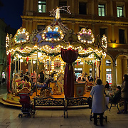 TREVISO, ITALY - DECEMBER 06: Parents and relatives wait for their little ones at a merry-go-round on December 6, 2011 in Treviso, Italy. Christmas Markets are popular in Northern Italian cities, selling festive items including lights, nativity scenes, decorations and local festive handicrafts. In most cities they will run from the end of November to January 6th HOW TO LICENCE THIS PICTURE: please contact us via e-mail at sales@xianpix.com or call our offices in London   +44 (0)207 1939846 for prices and terms of copyright. First Use Only ,Editorial Use Only, All repros payable, No Archiving.© MARCO SECCHI