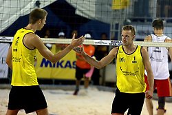 MANILA, May 6, 2018  Germany's Max-Jonas Karpa (R)/Milan Sievers celebrate during the men's gold medal match between Germany's Max-Jonas Karpa/Milan Sievers and Russia's Petr Bakhnar/Taras Myskiv at the FIVB Beach Volleyball World Tour in Manila, the Philippines, May 6, 2018. Germany's Max-Jonas Karpa/Milan Sievers won by 2-1 and claimed the title of the event. (Credit Image: © Rouelle Umali/Xinhua via ZUMA Wire)