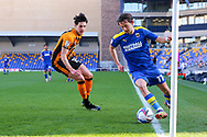 AFC Wimbledon midfielder Ethan Chislett (11) just keeping the ball in touch during the EFL Sky Bet League 1 match between AFC Wimbledon and Hull City at Plough Lane, London, United Kingdom on 27 February 2021.