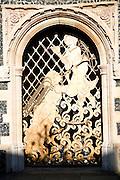 Decorative metalwork doorway, Church St Peter's by the waterfront, Ipswich, Suffolk, England,