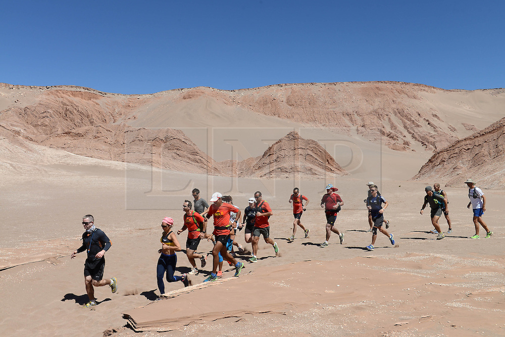 © Licensed to London News Pictures. 14/11/2013.<br /> <br /> Runners on a training run.<br /> <br /> Inaugural Volcano Marathon, Atacama Desert, Chile. The race took place in the Atacama Desert in Chile, beginning at an altitude of 4,400 metres (14,500 feet) in the vicinity of Lascar Volcano. It was a gruelling affair for many of the competitors who had to encounter some challenging hills and manage the impact of the heat and oxygen deprivation. The average altitude of the entire race was close to 4,000 metres and temperatures reached the mid 20s Celsius, or almost 80 Degrees Farenheit.<br /> <br /> Photo credit : Mike King/LNP<br /> <br /> Further information and link to video here: https://www.dropbox.com/s/0277bepxvo0t8il/Marathon%20copy.txt