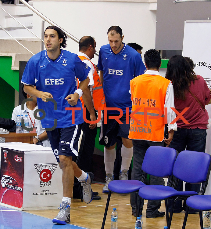 Anadolu Efes's Sasha VUJACIC (L) during their Turkey Cup Qualifying basketball first match Anadolu Efes between Turk Telekom at Aliaga Arena in Izmir, Turkey, Sunday, October 9, 2011. Photo by TURKPIX