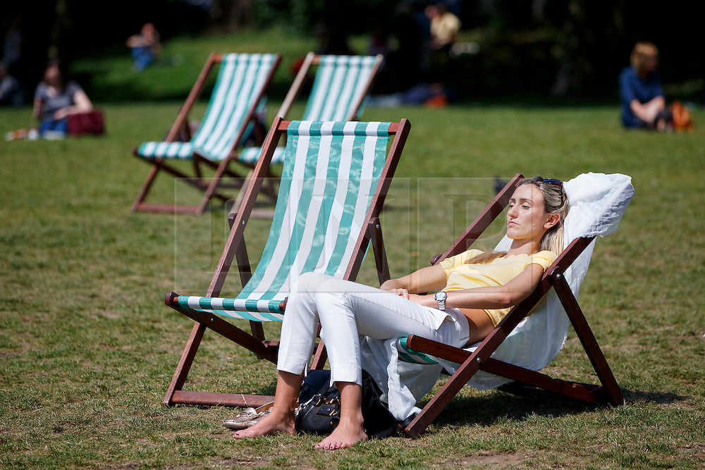 © Licensed to London News Pictures. 04/06/2015. London, UK. People enjoying the sunshine and warm weather in Green Park in London on Thursday, 4 June 2015 as temperature hits 22C. Photo credit: Tolga Akmen/LNP