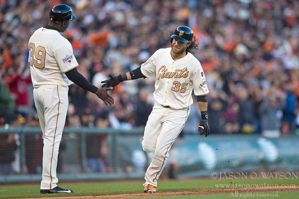 SAN FRANCISCO, CA - APRIL 18:  Brandon Crawford #35 of the San Francisco Giants is congratulated by third base coach Roberto Kelly #39 after hitting a two run home run against the Arizona Diamondbacks during the fourth inning at AT&T Park on April 18, 2015 in San Francisco, California.  (Photo by Jason O. Watson/Getty Images) *** Local Caption *** Brandon Crawford; Roberto Kelly