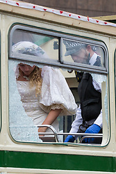 London, UK. 31st August, 2021. Metropolitan Police officers arrest an Extinction Rebellion activist dressed as a bride after a vintage bus was used as base to block a road junction to the south of London Bridge on the ninth day of Impossible Rebellion protests. Extinction Rebellion are calling on the UK government to cease all new fossil fuel investment with immediate effect.