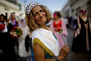 Yoli Mejia, 67, poses for a picture during a third age parade celebrating Saint Valentine's Day, Saturday, Feb. 14, 2009. (AP Photo/Rodrigo Abd)