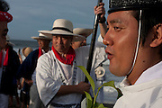 A Shinto priest watches mikoshi as they are carried into the sea during the Hamaorisai Matsuri that takes place on Southern Beach in Chigasaki, near Tokyo, Kanagawa, Japan Monday July 18th 2011. The festivals marks the celebration of Marine Day and the rescuing of a divine image that was washed ashore in the area. Over thirty Mikoshi or portable shrines are carried through the night from surrounding shrines to arrive on the beach for sunrise. There they are blessed and then carried into the surf to purify them.