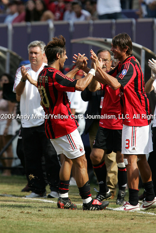 31 July 2005: Manuel Rui Costa (10) races to the bench to celebrate with Paolo Maldini (3) after scoring the game-tying goal late in the second half. Chelsea FC of England and AC Milan of Spain tied 1-1 at Giants Stadium in East Rutherford, New Jersey in an international friendly soccer match as part of AEG's 2005 World Series of Football. .