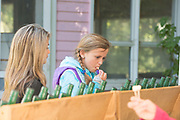 Young girls enjoy tasting flavored oils at the Thousand Springs Art Festival at Ritter Island near Hagerman, Idaho. MR