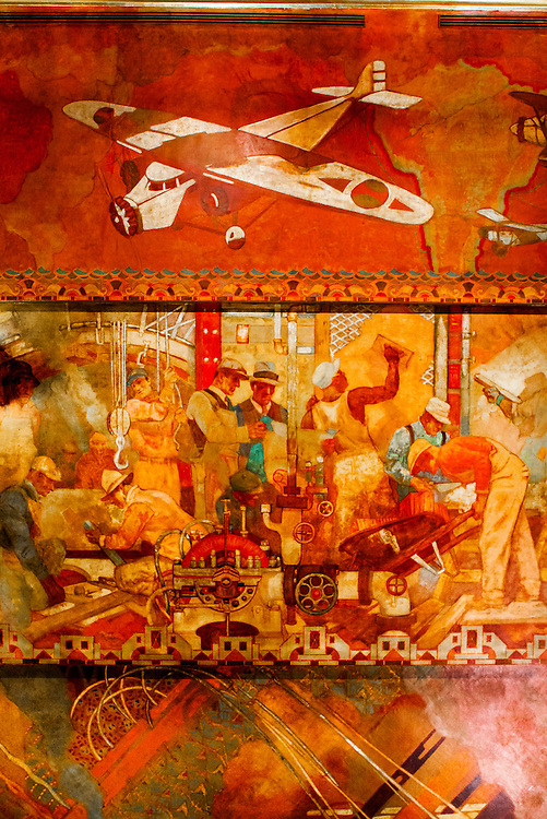 """This section of the huge """"Transport and Human Endeavor"""" mural on the walls and ceiling of the Chrysler Building's main lobby depicts scenes of heroic industrialism and early 20th Century transportation including the primative but rapidly developing aircraft of that period.<br /> <br /> Some of the scenes are said to depict the construction of the Chrysler building itself,<br /> <br /> The canvas mural was painted by Edward Trumbull in 1929, but was given a polyurethane coating in 1970 that darkened it, making it hard to see until a costly restoration in 1999."""