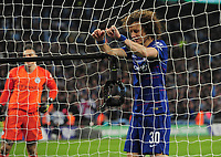 Football - 2019 EFL League Cup Final (Carabao Cup) - Manchester City vs. Chelsea<br /> <br /> David Luiz of Chelsea grabs the net after missing his penalty in the shoot out, at Wembley Stadium.<br /> <br /> COLORSPORT/ANDREW COWIE
