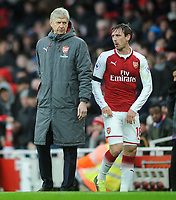 Football - 2017 / 2018 Premier League - Arsenal vs. Crystal Palace<br /> <br /> Arsenal Manager, Arsene Wenger with Nacho Monreal being substituted after getting injured, at The Emirates.<br /> <br /> COLORSPORT/ANDREW COWIE