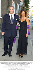 MR MARK SHAND brother of Camilla Parker Bowles and his wife CLEO, at a wedding in Suffolk in London on 20th September 2003.PMT 123